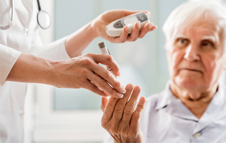 older gentleman getting his insulin tested